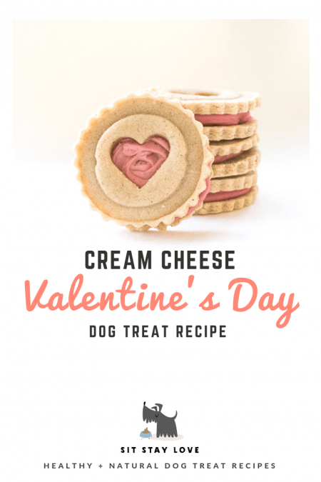 Cream cheese biscuits for dogs with cut-out heart shape and pink frosting