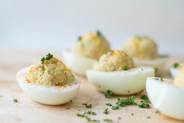 Deviled eggs for dog seasoned with parsley and turmeric